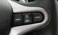 an electronic device in a motor vehicle that can be switched on to maintain a selected constant speed without the use of the accelerator